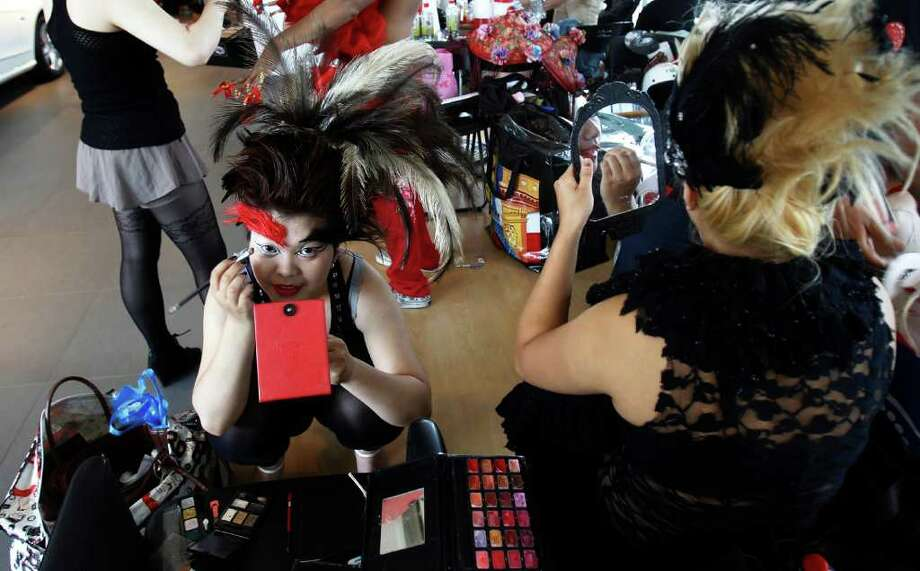 "Fans of international pop sensation Lady Gaga prepare their costumes during a ""Lady Gaga Day"" fashion show before her evening mini concert in Taichung, Taiwan, Sunday, July 3, 2011. Photo: AP"