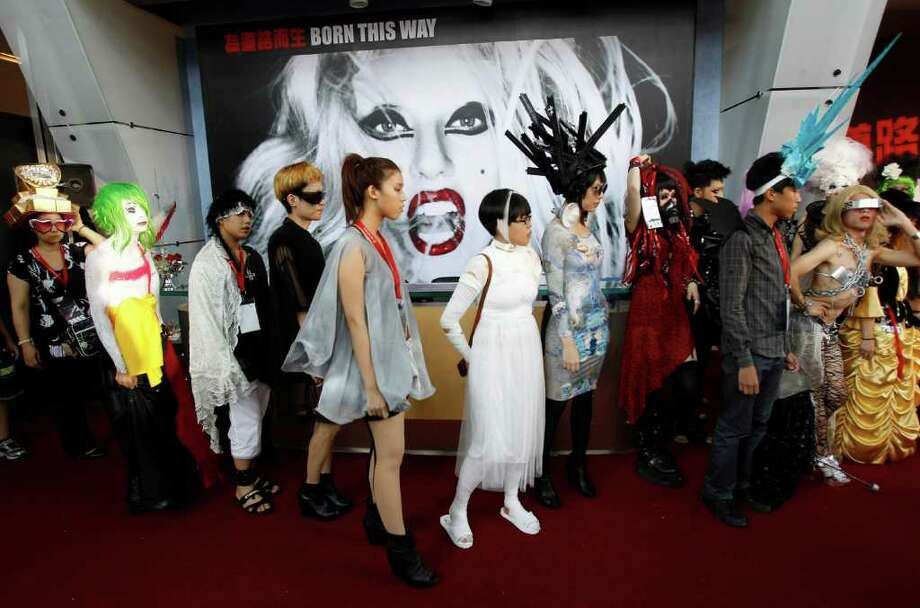 "Fans of international pop sensation Lady Gaga dress in costume during a ""Lady Gaga Day"" fashion show before her evening mini concert in Taichung, Taiwan, Sunday, July 3, 2011. Photo: AP"