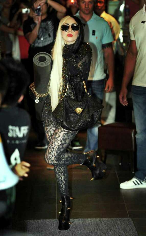 "International pop diva Lady Gaga poses as she leaves a yoga studio in Taipei, Taiwan, Saturday, July 2, 2011. Gaga is in Taiwan for five days on a promotional tour for her new album ""Born This Way."" Photo: AP"