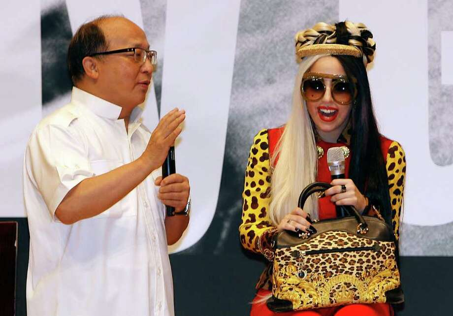 "International pop sensation Lady Gaga laughs with Taichung Mayor Jason Hu during a welcoming ceremony on ""Lady Gaga Day"" in Taichung, Taiwan, Sunday, July 3, 2011. Photo: AP"