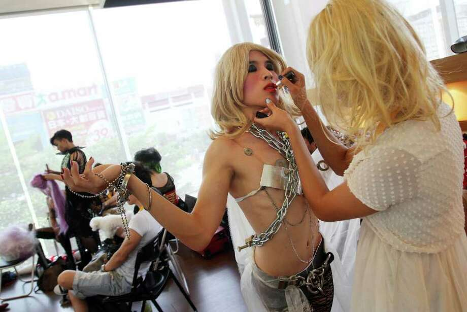 "Fans of international pop sensation Lady Gaga prepare their makeup and costume during a ""Lady Gaga Day"" fashion show held before her evening mini concert in Taichung, Taiwan, Sunday, July 3, 2011. Lady Gaga is visiting Taiwan for five days promoting her new album ""Born This Way."" Photo: AP"
