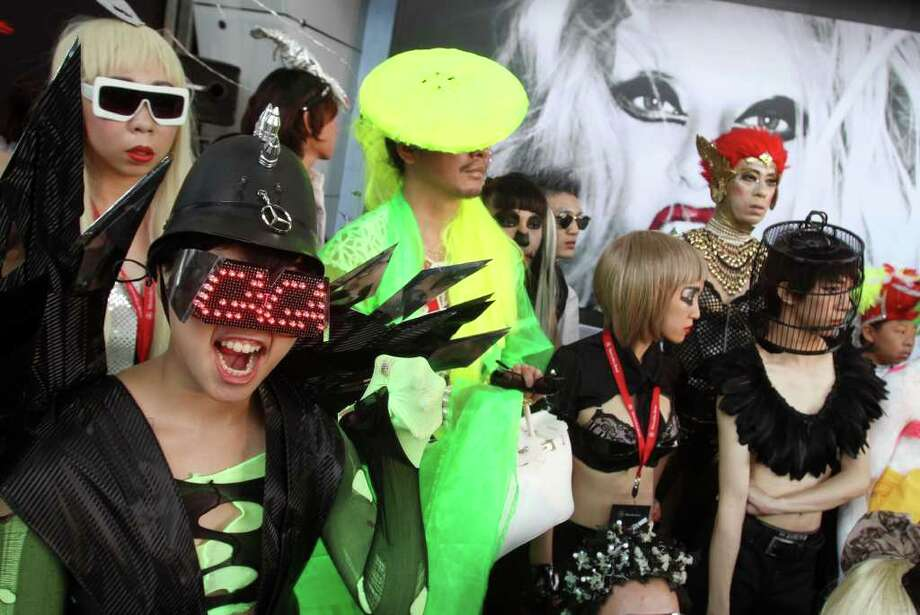 "Fans of international pop sensation Lady Gaga dress in costume during a ""Lady Gaga Day"" fashion show held before her evening mini concert in Taichung, Taiwan, Sunday, July 3, 2011. Lady Gaga is visiting Taiwan for five days promoting her new album ""Born This Way."" Photo: AP"