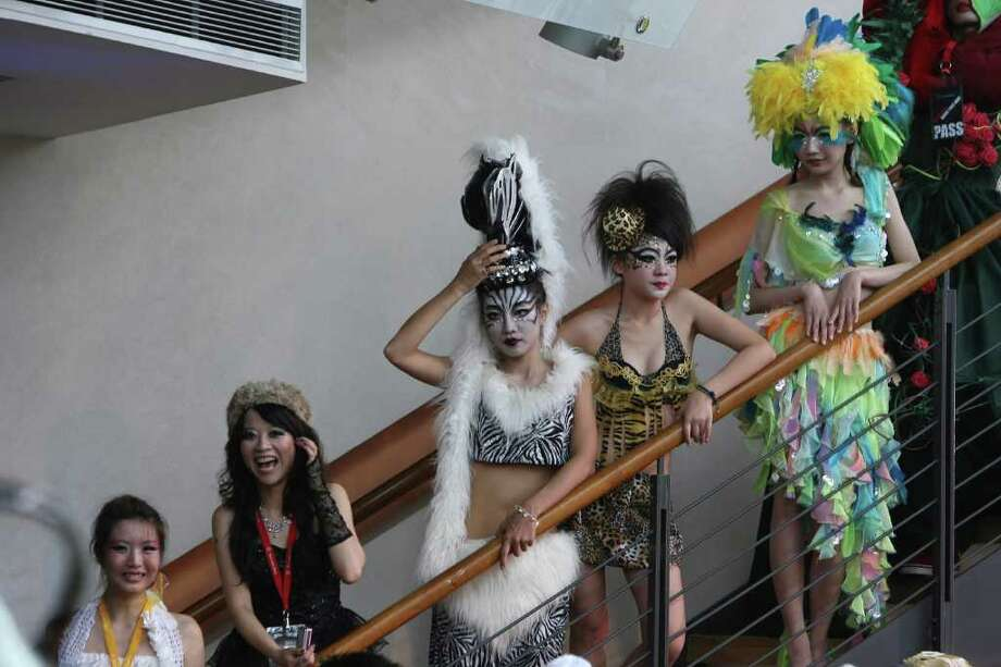 "Fans of international pop sensation Lady Gaga prepare for a ""Lady Gaga Day"" fashion show in before her evening mini concert in Taichung, Taiwan, Sunday, July 3, 2011. Photo: AP"