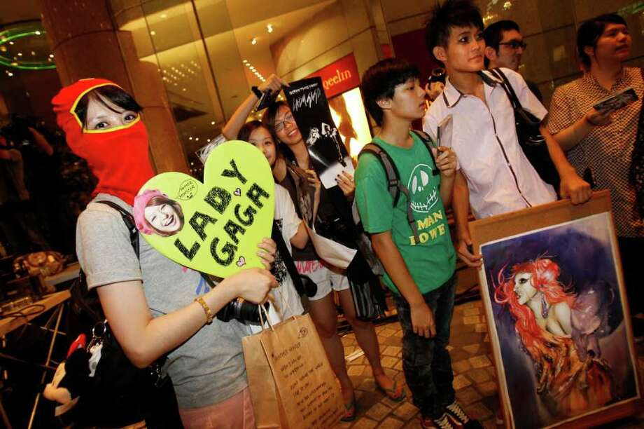 "Fans wait for international pop diva Lady Gaga to arrive at her hotel in Taipei, Taiwan, Friday, July 1, 2011. Lady Gaga slipped into the hotel unbeknownst to the waiting crowd of fans. Lady Gaga is in Taiwan for five days on a promotional tour for her new album ""Born This Way."" Photo: AP"