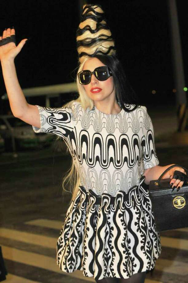 "International pop diva Lady Gaga waves upon arrival at the Taipei International Airport in Taoyuan, Taiwan, Friday, July 1, 2011. Gaga slipped into a hotel unbeknownst to the waiting crowd of fans. Gaga is in Taiwan for five days on a promotional tour for her new album ""Born This Way."" (AP Photo) TAIWAN OUT Photo: AP"