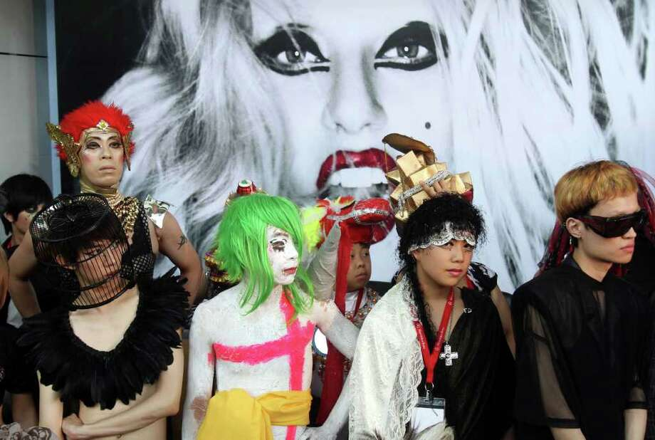 "Fans of international pop sensation Lady Gaga dress in costume during ""Lady Gaga Day"" fashion show held before her evening mini concert in Taichung, Taiwan, Sunday, July 3, 2011. Lady Gaga is visiting Taiwan for five days promoting her new album ""Born This Way."" Photo: AP"