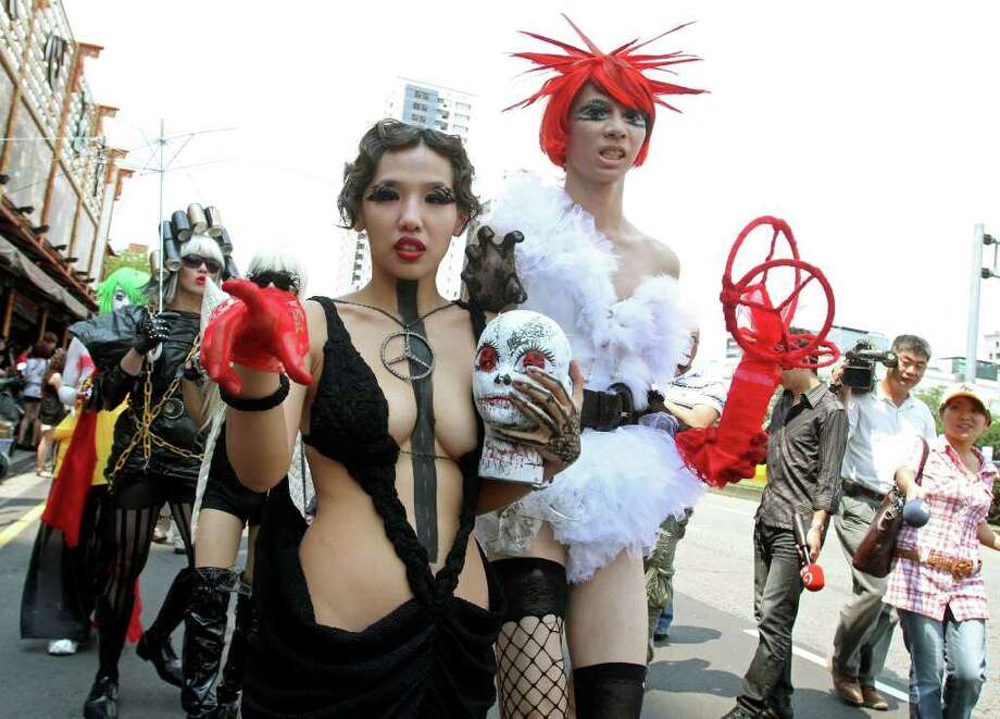 "Fans of international pop sensation Lady Gaga dresses in costume during ""Lady Gaga Day"" parade before her evening mini concert in Taichung, Taiwan, Sunday, July 3, 2011. Lady Gaga is visiting Taiwan for five days promoting her new album ""Born This Way."" Photo: AP"