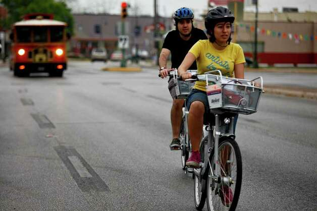 Claudia Zarazua and Ruben Mancha ride B-cycles from the San Antonio B-cycle HUB to the B-cycle station at La Villita on Saturday, March 26, 2011. Photo: Lisa Krantz/lkrantz@express-news.net / SAN ANTONIO EXPRESS-NEWS