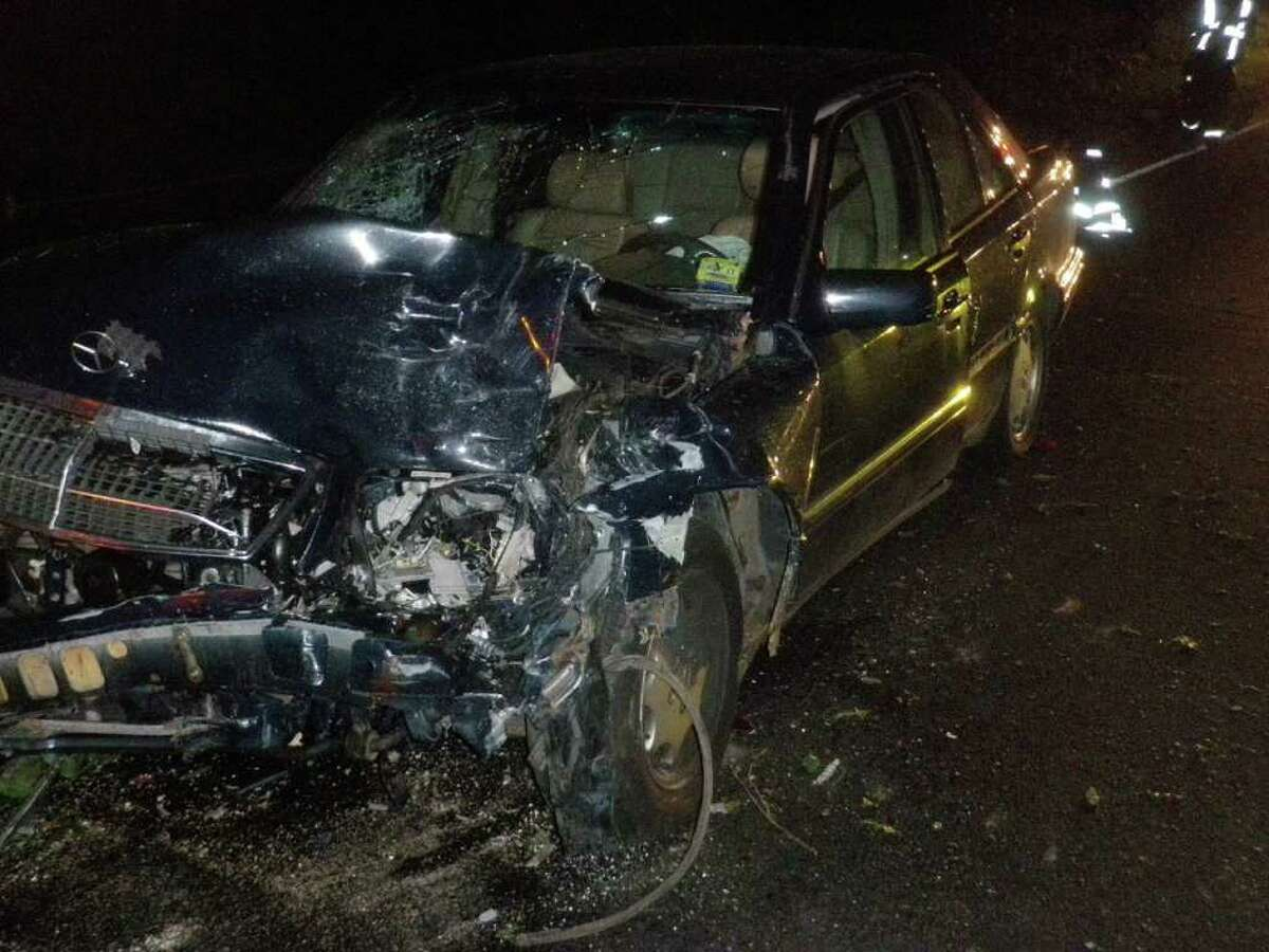 This car was damaged in a multi-vehicle crash triggered Sunday night when a tree fell across the northbound lanes on the Merritt Parkway in Westport.