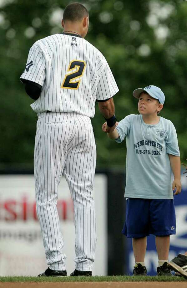 TRENTON, NJ - JULY 2: Derek Jeter of the New York Yankees shakes hands with a young boy after the national anthem during his minor league rehab start with the Trenton Thunder in a game against the Altoona Curve on July 2, 2011 at Mercer County Waterfront Park in Trenton, New Jersey. Jeter is set to rejoin the Yankees in Cleveland on Monday in his return from a calf injury. (Photo by Rich Schultz/Getty Images) Photo: Rich Schultz, Getty Images / 2011 Getty Images