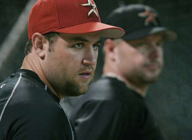 Houston Astros Lance Berkman, left, and Roger Clemens stand together during practice Thursday, July 14, 2005, in Houston. After a slow start the Astros went into the All-Star break with 16 wins in 20 games. Photo: PAT SULLIVAN, AP / AP