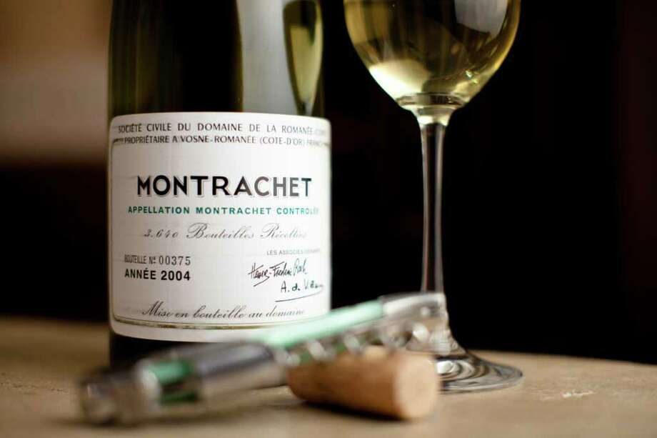 A 2004 Domaine de la Romanee-Conti Montrachet from Dr. Devinder Bhatia's subterranean wine cellar which can hold up to 14,000 bottles but currently has around 6,000, Tuesday, June 7, 2011, in Houston. ( Michael Paulsen / Houston Chronicle ) Photo: Michael Paulsen, Staff / © 2011 Houston Chronicle