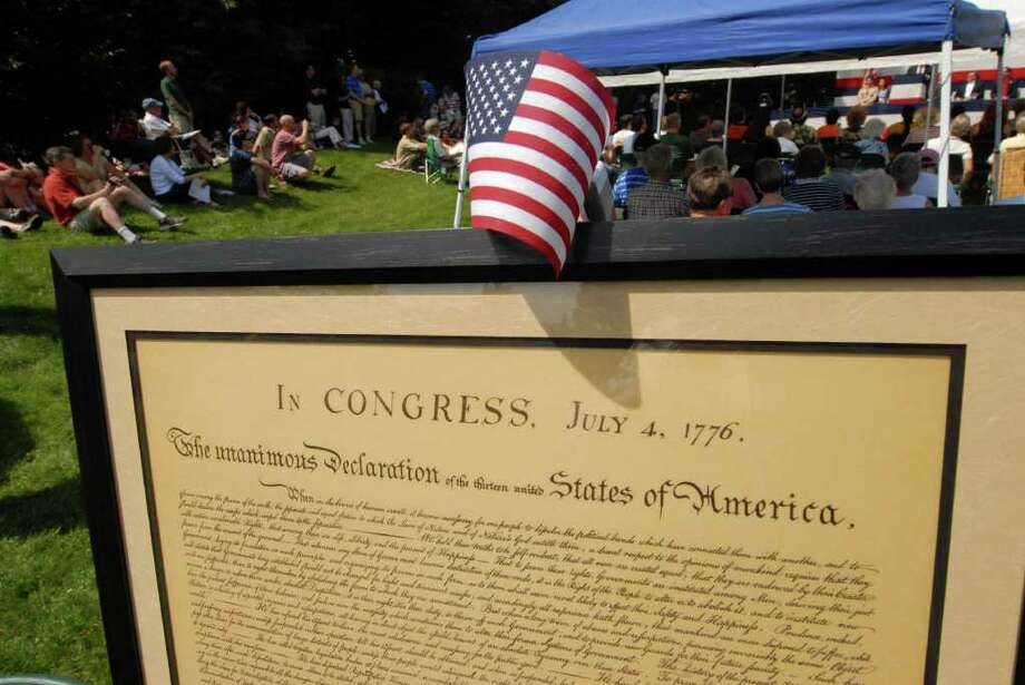 A reproduction of the Declaration of Independence was displayed outside Bethlehem Town Library in Delmar, where a crowd gathered to hear a reading of the cherished document and celebrate Independence Day Monday morning.  (Will Waldron /Times Union) Photo: Will Waldron