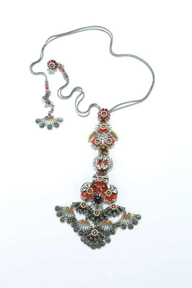 Miriam Haskell pendant, $660, Tootsies is shown in the Chronicle Studio Tuesday, June 7, 2011, in Houston. ( Brett Coomer / Houston Chronicle ) Photo: Brett Coomer, Staff / © 2011 Houston Chronicle