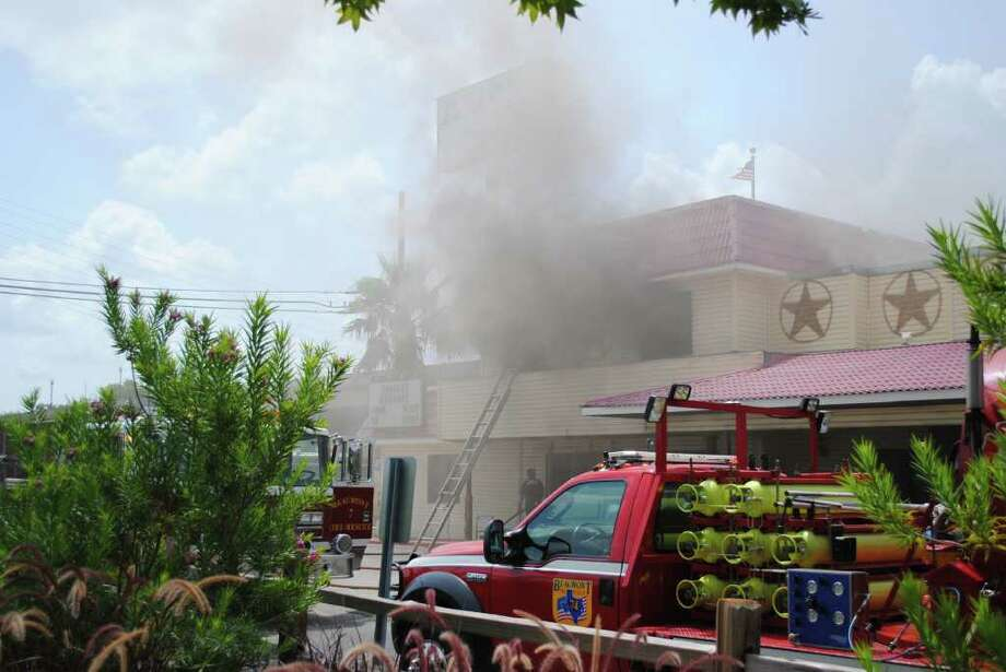 Beaumont Firefighters battled a blaze Monday morning  that erupted in near the front bar of Alibi's Restaurant and Bar. Photo: Amos Morale III