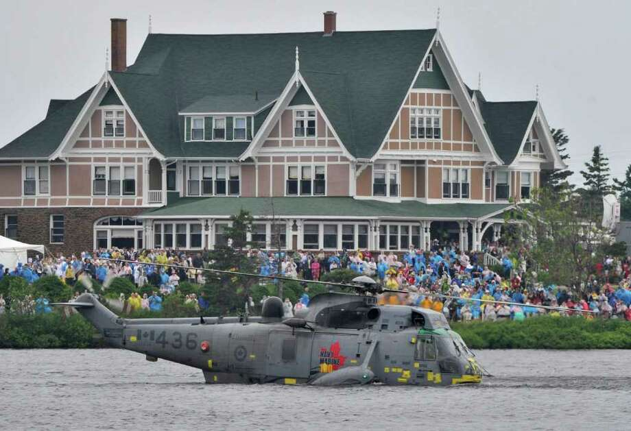 A Canadian Forces Sea King helicopter with the Duke of Cambridge on board takes part in a search and rescue demonstration in Dalvay by-the-Sea, Prince Edward Island, Monday, July 4, 2011. (AP Photo/TheCanadian Press, Paul Chiasson) Photo: Paul Chaisson