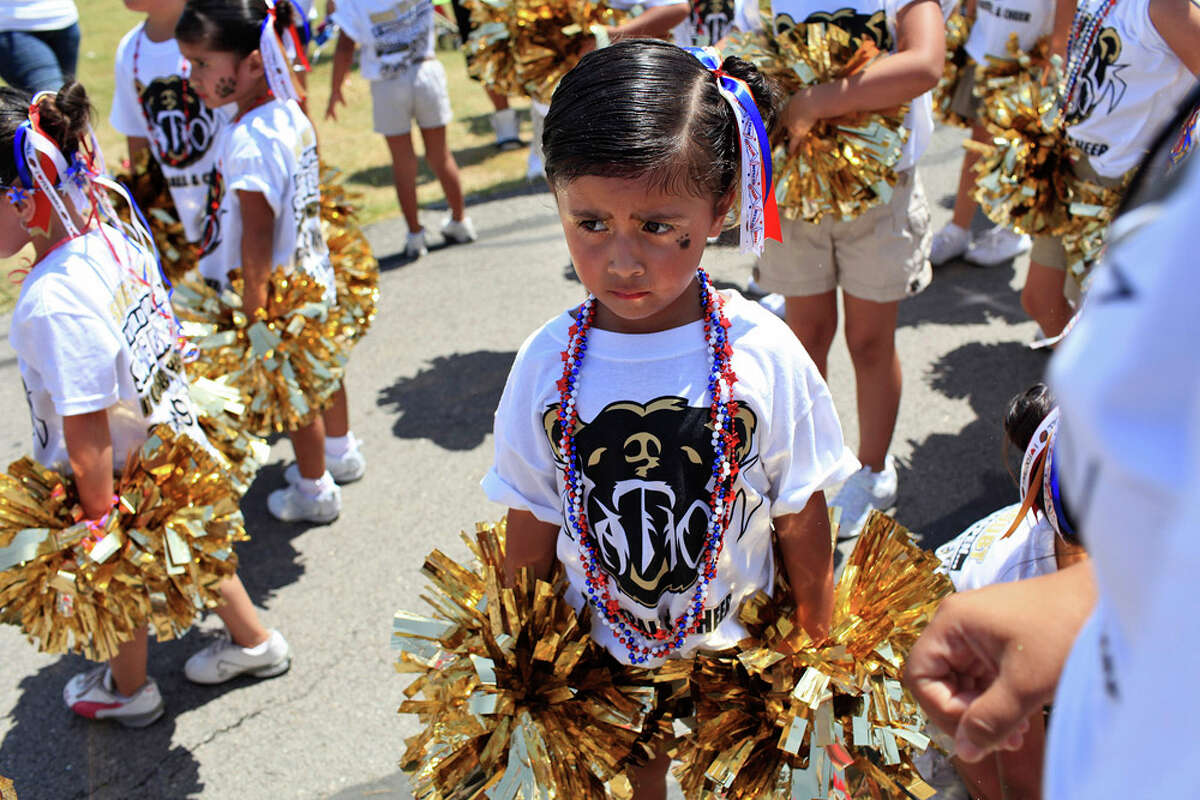BearsNation cheerleader Emma Menchaca, 3, waits to do a cheer with fellow cheerleaders during the