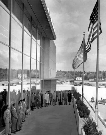 The Oct. 12, 1950 photo caption read: An impressive presentation ceremony, pictured above, the banner of the United Nations is being raised on a flagstaff beside that of the Stars and Stripes outside the Bon Marche's Northgate store. Photo: Seattlepi.com File