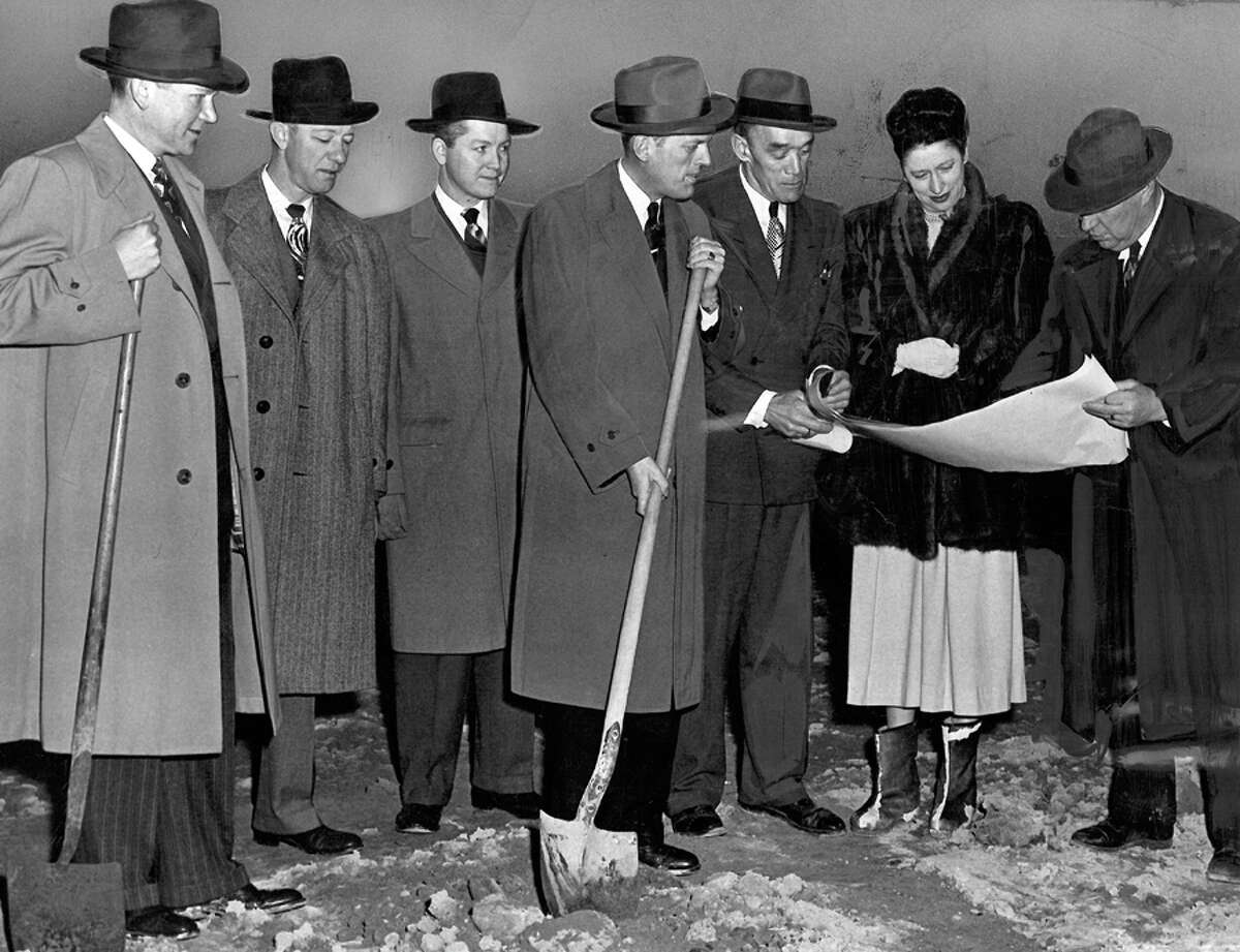 The caption for the Northgate ground breaking photo read: Starting on the Bon Marche's new 3 million dollar store in Seattle's North End was signaled yesterday by ground breaking ceremony. Taking part, left to right, are Rex Allison, president; Lawrence Lean, merchandising vice president; Wilmar Hill, divisional merchandising manager; Norman Gates, future manager of Northgate; C.R. Swinford of John Graham and Company, architects; Donna Newell Ames, sales promotion director, and C.J. Williams of Howard S. Wright and Company, general contractor.
