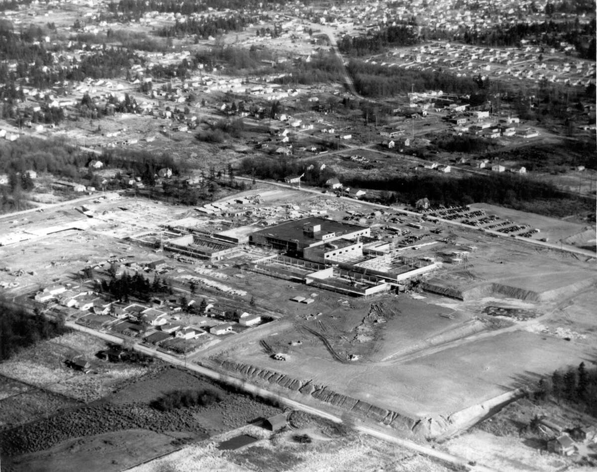An aerial view of Northgate looking northeast, Dec. 6, 1949. In the foreground is First Avenue Northeast and a tract of homes. The homes there and in the upper left center are now part of the mall. The Bon Marche building, now Macy's, is the largest building pictured here.