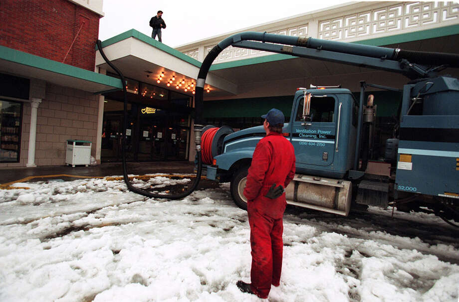 The Dec. 30, 1996 photo caption read: Bill Benner of the Ventilation Power Cleaning, Inc. runs his rig that is pumping water from the roof of the Northgate Shopping Mall to reduce pressure on the roof. Photo: Seattlepi.com File