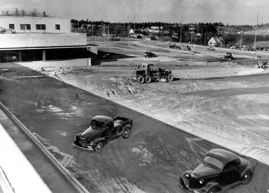The caption for this April 3, 1950 photo read: Scrapers remove mud from the vast parking area adjacent to the Bon Marche, Northgate. Thousands of cubic yards of muddy clay are being carted away so that a firm base can be laid for the asphalt top. Parking will be provided for about 4,000 cars at Northgate, the modern shopping city nearing completion on a 50-acre tract bounded by 1st and 5th Aves. N.E. and E. 103d and 110th Sts. Photo: Seattlepi.com File