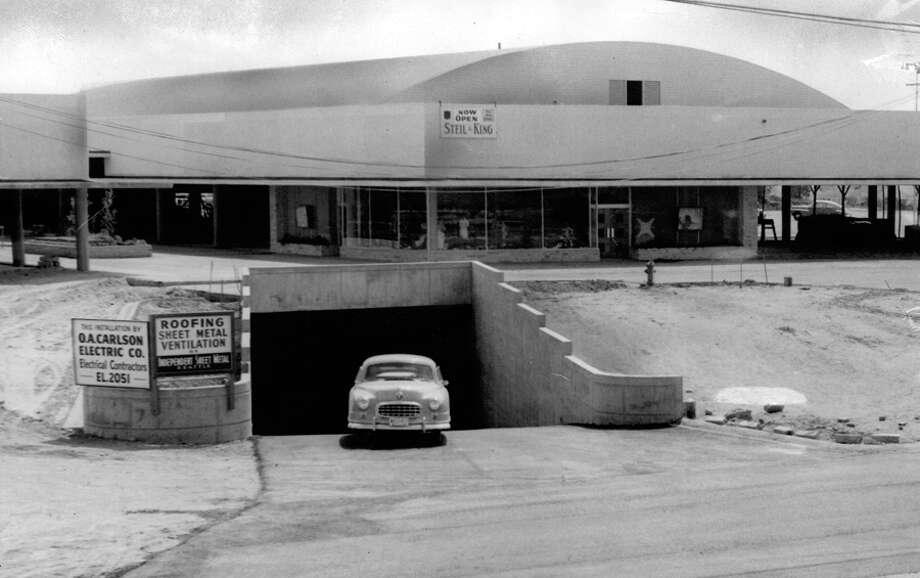 "The July 25, 1950 photo caption read: An automobile emerges from the 1,200-foot Northgate Concourse, opened for business Thursday. Concourse is ""main artery"" of the shopping center. All deliveries to and from every store will be made through it. Concourse runs from E. 110th St., where this picture was taken, underground to E. 103d St. Photo: Seattlepi.com File"