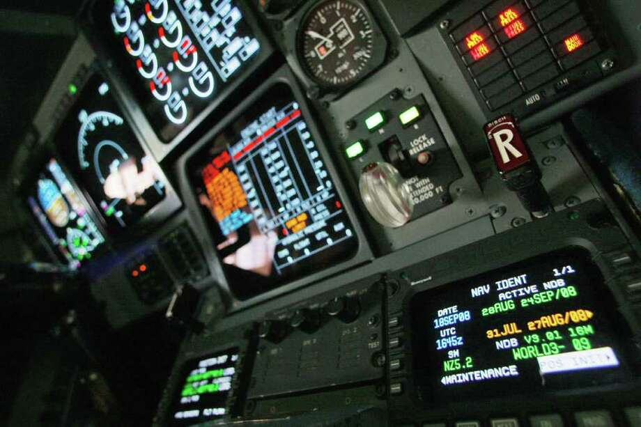 FILE - In this Sept. 18, 2008 file photo, navigation controls are seen in the cockpit of a FAA Gulfstream jet at a hangar at Washington's Reagan National Airport. Industry officials say the federal program to create a new air traffic control system is at a crossroads, making delays possible. (AP Photo/Charles Dharapak, File) Photo: Charles Dharapak