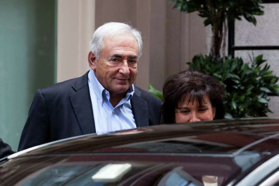Former International Monetary Fund leader Dominique Strauss-Kahn leaves his temporary residence in Tribeca, Saturday, July 2, 2011, in New York.  A judge released him Friday without bail or home confinement in the sexual assault case against him after prosecutors acknowledged serious questions about the credibility of the hotel maid who accused him of sexual assault. The criminal case against him stands. (AP Photo/John Minchillo) Photo: John Minchillo