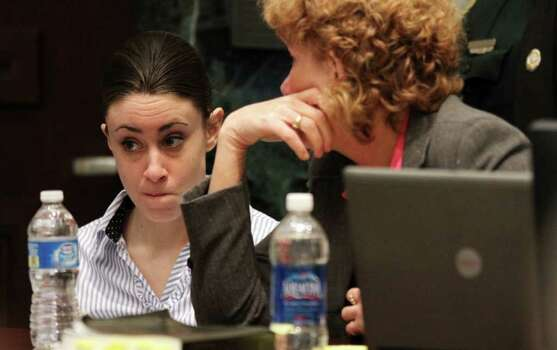 Casey Anthony with her attorney Dorothy Clay Sims on the last day of arguments in Anthony's murder trial at the Orange County Courthouse in Orlando, Fla. on Monday, July 4, 2011. Anthony has plead not guilty to first-degree murder in the death of her daughter, Caylee, and could face the death penalty if convicted of that charge. (AP Photo/Red Huber, Pool) Photo: Red Huber