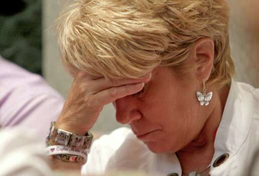 Cindy Anthony, wearing bracelets in tribute to her granddaughter Caylee Anthony, listens during the final day of arguments in the trial of her daughter Casey Anthony at the Orange County Courthouse in Orlando, Fla. on Monday, July 4, 2011. Anthony has plead not guilty to first-degree murder in the death of her daughter, Caylee, and could face the death penalty if convicted of that charge.  (AP Photo/Red Huber, Pool) Photo: Red Huber
