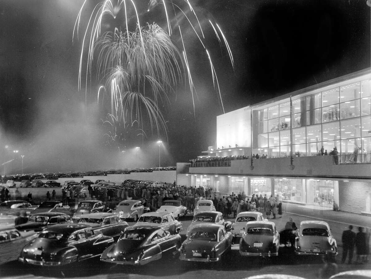 Northgate Mall opened April 21, 1950. Northgate, in North Seattle now and part of unincorporated King County when it opened, was the first suburban mall of its kind in the United States. This photo shows fireworks for the opening weekend of the Bon Marche at Northgate Mall, April 30, 1950. Macy's is now where the Bon Marche was.