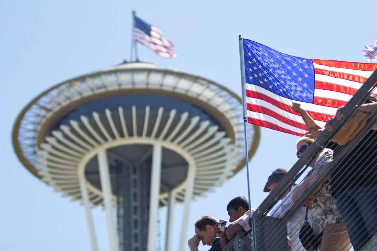 Hundreds gather at the 27th annual Naturalization Ceremony produced by the Ethnic Heritage Council at the Seattle Center on Monday, July 4, 2011. More than 500 peoples from more than 80 countries were reported to have been sworn in as new American citizens, according to the council.