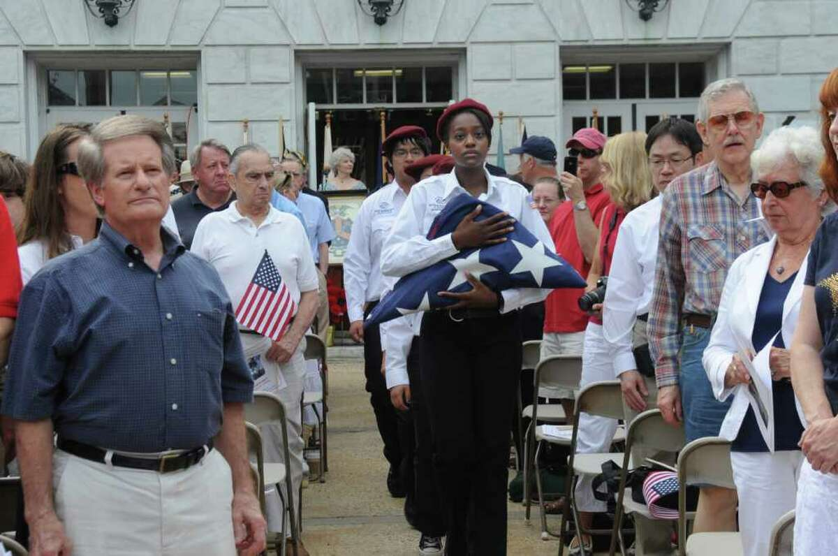 Noelle Valentine, center, of the Boys & Girls Club of Greenwich Honor Guard, carries the flag at the Fourth of July Ceremony, at Greenwich Town Hall, on July 4, 2011.