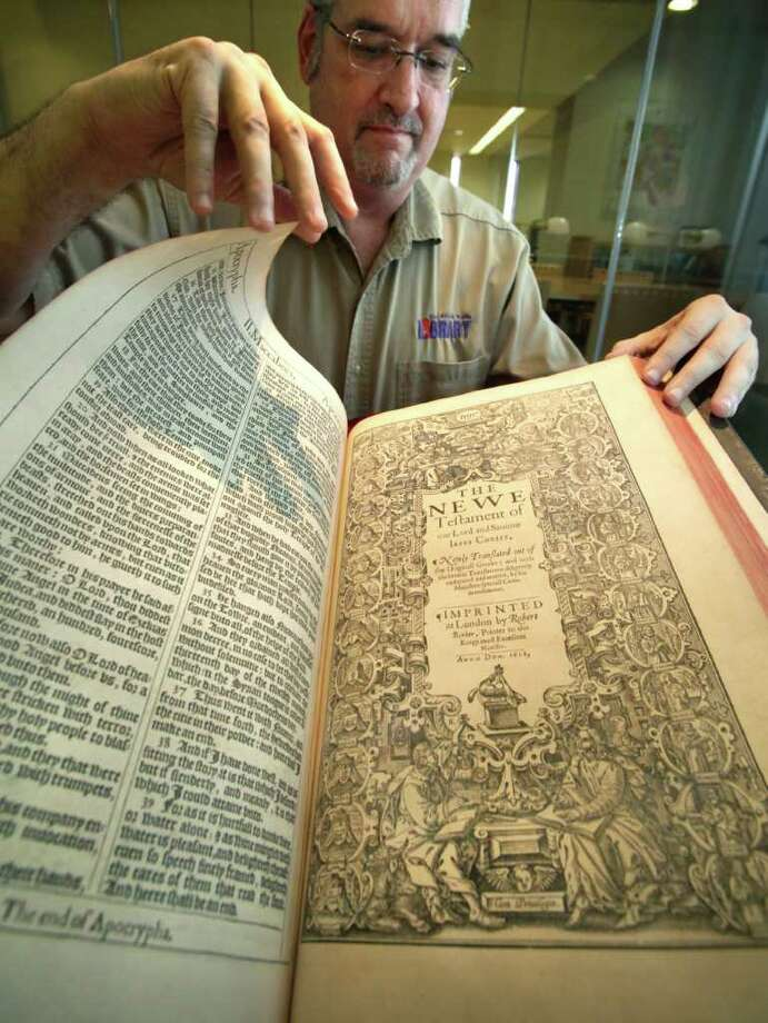 Matt DeWaelsche, assistant manager and archivist at the Central Library, turns the page on the first-edition 1611 King James Bible which is part of the Library's collection.  The book, published in London, is now 400 years old. Friday, July 1, 2011. Photo Bob Owen/rowen@express-news.net Photo: Bob Owen,  Bob Owen/rowen@express-news.net / rowen@express-news.net