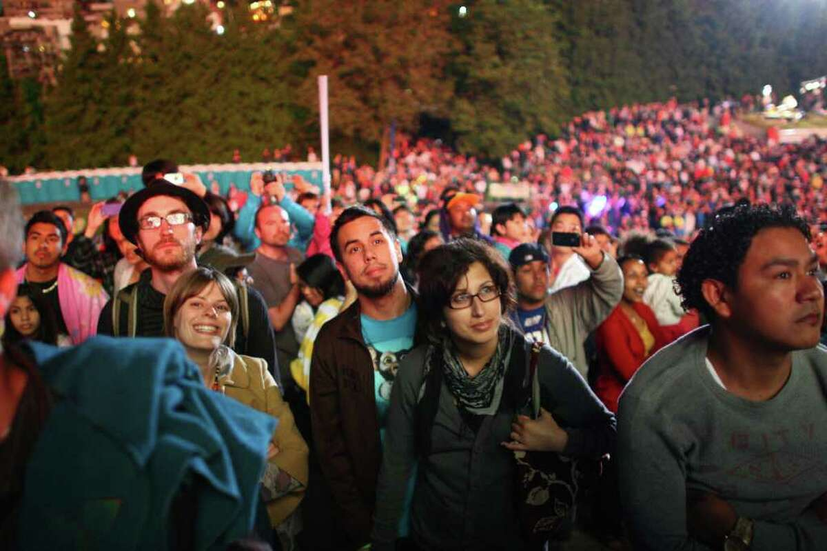 Spectators watch as fireworks explode on Monday, July 4, 2011 at Gas Works Park on Lake Union in Seattle during the Family 4th.