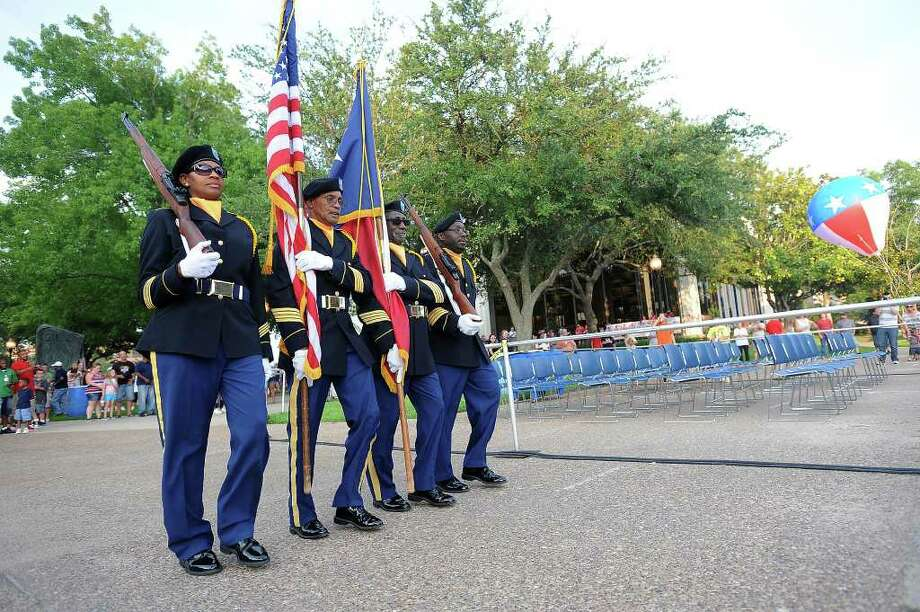 The color guard presents the flags during Beaumont's Fourth of July celebration on Monday. Guiseppe Barranco/The Enterprise Photo: Guiseppe Barranco