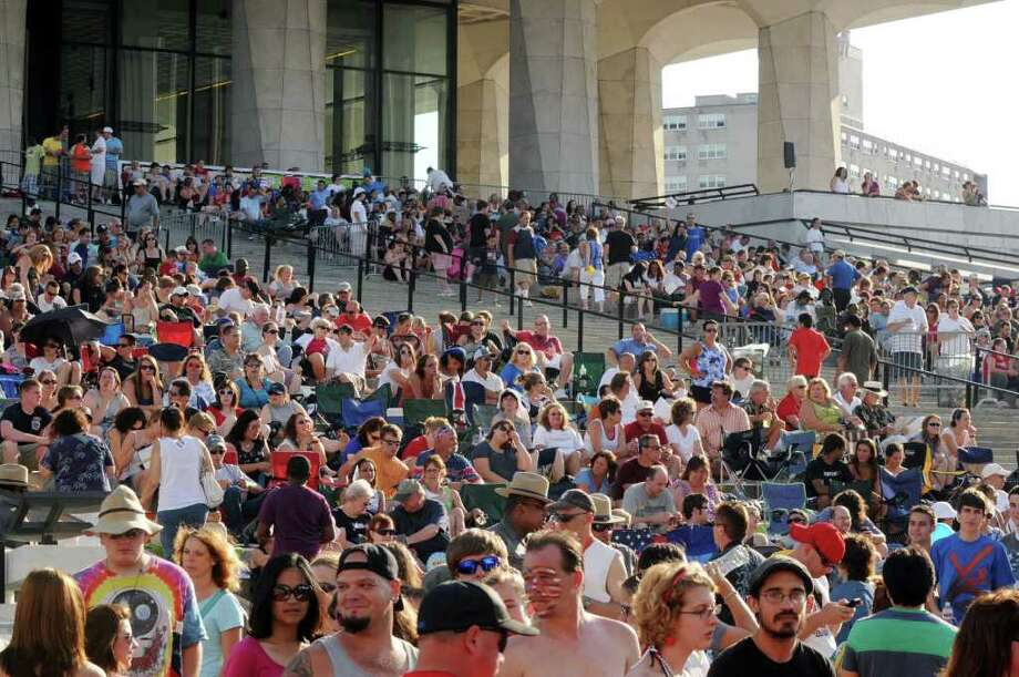 Revelers gather on Empire State Plaza in Albany, N.Y., Monday evening July 4 2011, for Price Chopper?s Homegrown 4th and Fireworks Festival show. (Will Waldron /Times Union) Photo: Will Waldron