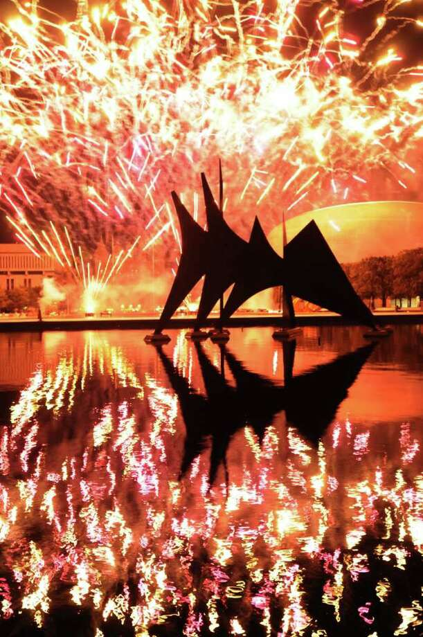 Fireworks light up the sky above Empire State Plaza in Albany, N.Y., Monday July 4, 2011, during Price Chopper?s Homegrown 4th and Fireworks Festival show. (Will Waldron /Times Union) Photo: Will Waldron