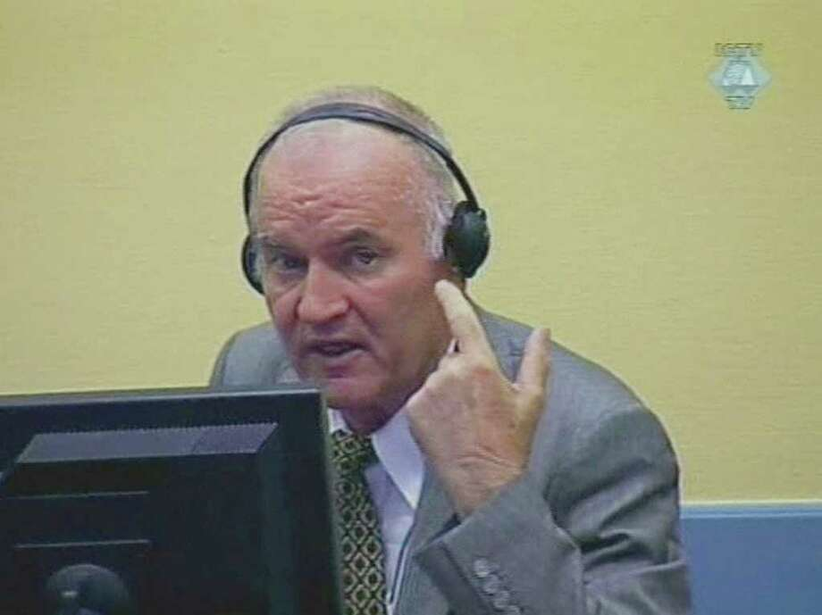 In this image taken from TV former Bosnian Serb military chief Ratko Mladic sits in the court room during his further initial appearance at the U.N.'s Yugoslav war crimes tribunal in The Hague, Netherlands, Monday, July 4, 2011. Mladic has appeared in court at the Yugoslav war crimes tribunal to enter pleas to charges including genocide. The judge refused a request by Ratko Mladic's court-appointed lawyer to postpone initial plea. (AP Photo/ICTY via APTN) / ICTY Via APTN