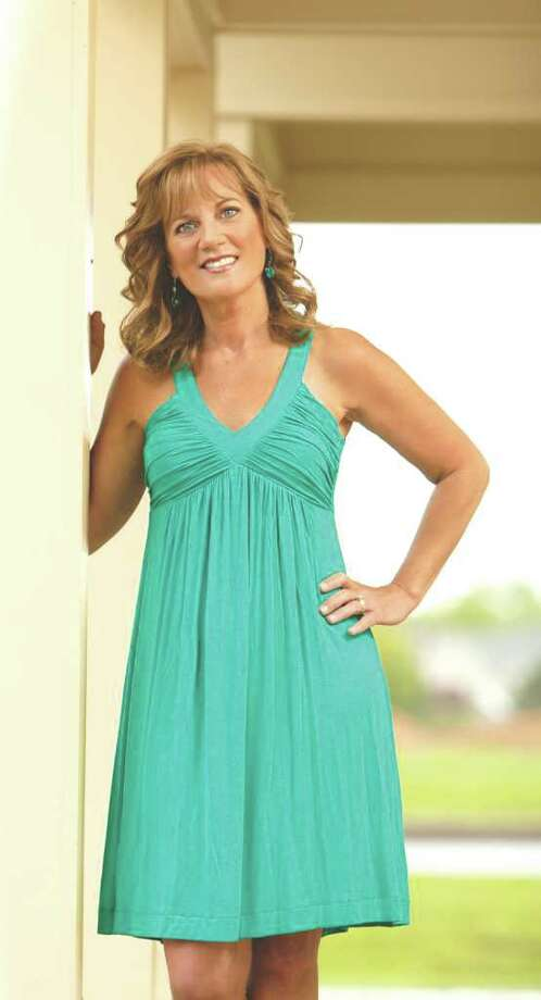 Cover model Pam Lajeunesse in a Jewel Green Sleeveless Dress by Calvin Klein. Earrings by Ashley Cooper. Select clothes and jewelry available at Boscov's Clifton Park. Hair and makeup by Kimberley's A Day Spa, Latham. (Photo by Suzanne  Kawola/HealthyLife)