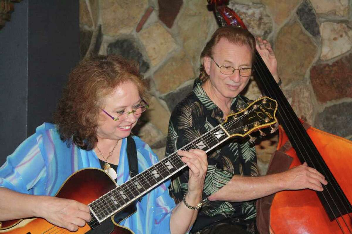Polly Harrison performs with Chuck Moses on bass.