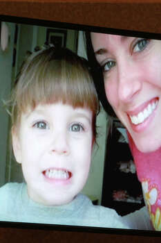 An image displayed on a courtroom monitor shows a photo entered into evidence in the Casey Anthony trial at the Orange County Courthouse on Friday, June 10, 2011.  The photo shows Caylee Anthony and her mother Casey. An expert witness used this photo to superimpose an image of Caylee's skull to mark where duct tape found on the remains would have been positioned on the child when she was alive. Photo: Joe Burbank, Orlando Sentinel