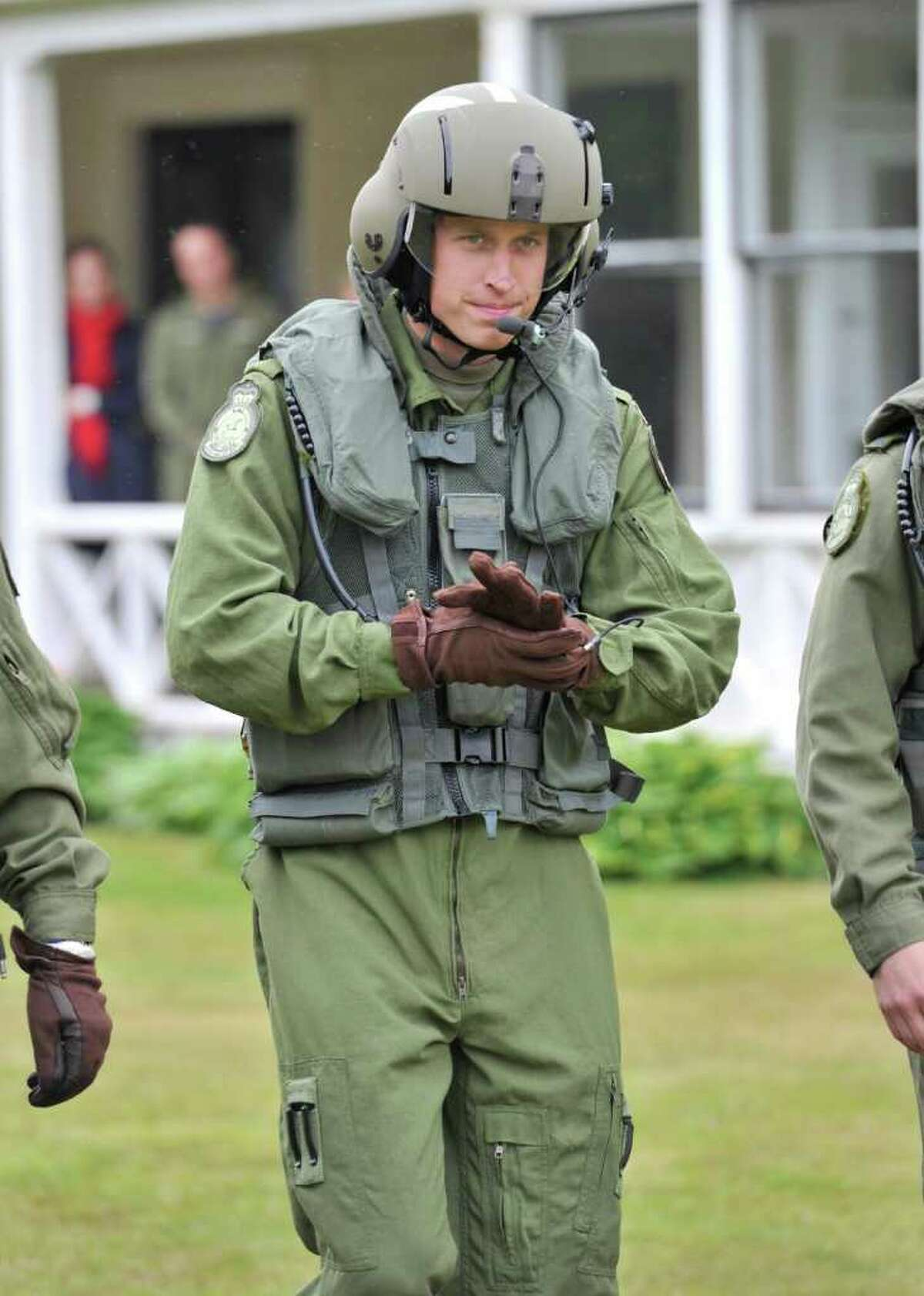 Prince William, The Duke of Cambridge, heads toward a Sea King helicopter for a training exercise, in Dalvay by-the-Sea, Prince Edward Island, Monday, July 4, 2011. Prince William will pilot a Canadian military helicopter and land it on the water for the first time as part of a military emergency training exercise. READ THE STORY