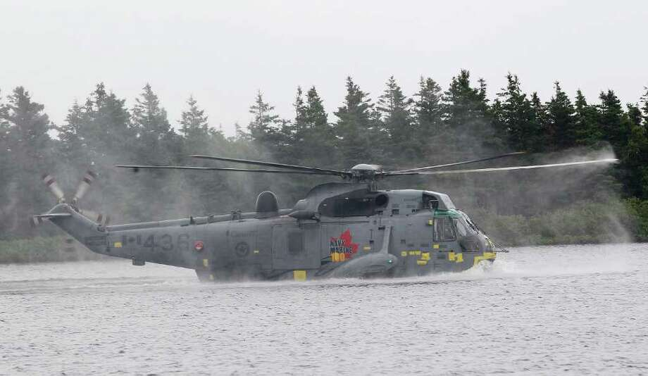 CHARLOTTETOWN, PE - JULY 04:  Prince William, Duke of Cambridge takes part in a demonstration of waterbirding during an exercise in a Sea King Helicopter on July 4, 2011 in Charlottetown, Canada. The newly married Royal Couple are on the fifth day of their first joint overseas tour. The 12 day visit to North America is taking in some of the more remote areas of the country such as Prince Edward Island, Yellowknife and Calgary. The Royal couple started off their tour by joining millions of Canadians in taking part in Canada Day celebrations which mark Canada's 144th Birthday.  (Photo by Chris Jackson/Getty Images) Photo: Chris Jackson, Getty Images / 2011 Getty Images