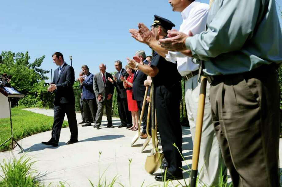 Jim Gordon, chairman of the monument committee, left, introduces officials during the ground breaking for a city 9/11 Memorial on Tuesday, July 5, 2011, in Troy, N.Y. (Cindy Schultz / Times Union) Photo: Cindy Schultz