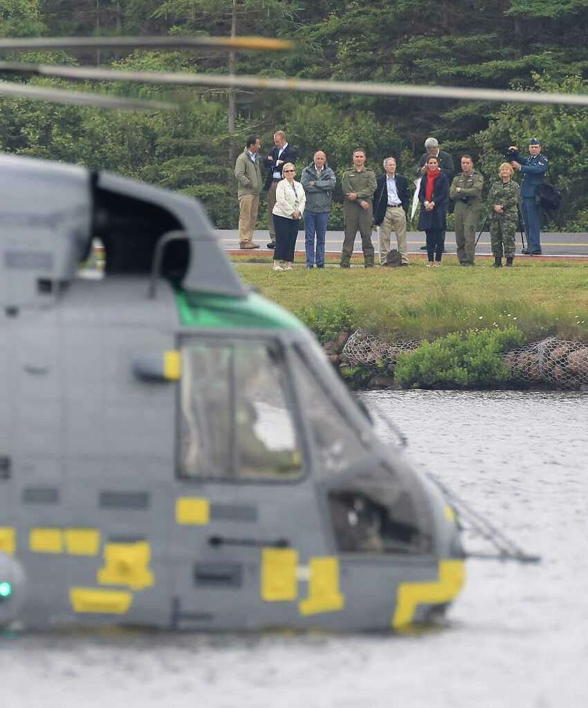 CHARLOTTETOWN, PE - JULY 04: Prince William, Duke of Cambridge takes part in an exercise in a Sea King Helicopter as Catherine, Duchess of Cambridge watches from the shore on Dalvay lake on July 4, 2011 in Charlottetown, Canada. The newly married Royal Couple are on the fifth day of their first joint overseas tour. The 12 day visit to North America is taking in some of the more remote areas of the country such as Prince Edward Island, Yellowknife and Calgary. The Royal couple started off their tour by joining millions of Canadians in taking part in Canada Day celebrations which mark Canada's 144th Birthday. (Photo by Chris Jackson/Getty Images)