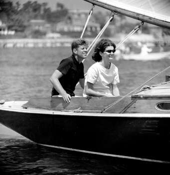 Sen. John F. Kennedy and his wife Jacqueline relax aboard the family yacht, Marlin, before sailing around Nantucket Sound at Hyannis Port, Mass., in this July 19, 1960 file photo.