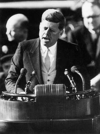 """President John F. Kennedy delivers his inaugural address after taking the oath of office at the Capitol in Washington in this Jan. 20, 1961, file photo. During this historic speech Kennedy wagged his index finger as he said, """"Ask not what your country can do for you, ask what you can do for your country."""" Photo: STF / AP"""