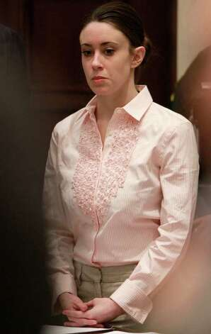Casey Anthony stands for the arrival of the jury at the start of the second day of jury deliberations in her murder trial at the Orange County Courthouse in Orlando, Fla., Tuesday, July 5, 2011. Anthony has plead not guilty to first-degree murder in the death of her daughter, Caylee, and could face the death penalty if convicted of that charge. Photo: AP